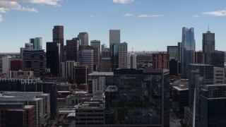 DX0001_001507 - 5.7K stock footage aerial video of the city's skyline seen while ascending near office buildings in Downtown Denver, Colorado