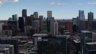 DX0001_001509 - 5.7K stock footage aerial video of a reverse view of the city's skyline seen from an office building in Downtown Denver, Colorado