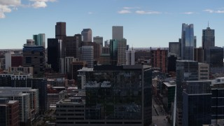 DX0001_001510 - 5.7K stock footage aerial video of the city's skyline seen during descent by office building in Downtown Denver, Colorado