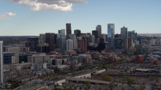 DX0001_001513 - 5.7K stock footage aerial video of the city's skyline seen from near a residential skyscraper in Downtown Denver, Colorado
