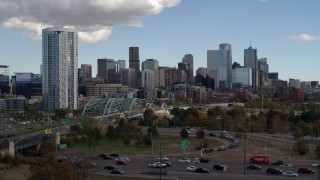 DX0001_001518 - 5.7K stock footage aerial video of a stationary view of a residential skyscraper and city skyline in Downtown Denver, Colorado