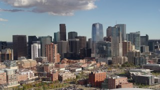 DX0001_001521 - 5.7K stock footage aerial video of slowly passing the city skyline in Downtown Denver, Colorado