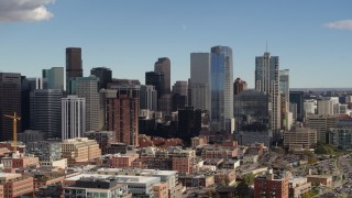 DX0001_001523 - 5.7K stock footage aerial video of towering skyscrapers of the city skyline in Downtown Denver, Colorado
