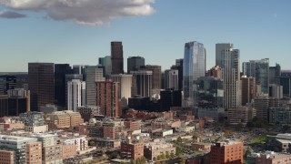 DX0001_001525 - 5.7K stock footage aerial video of flying past towering skyscrapers of the city skyline in Downtown Denver, Colorado