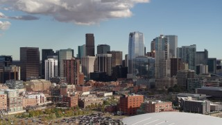 DX0001_001526 - 5.7K stock footage aerial video of passing towering skyscrapers of the city skyline in Downtown Denver, Colorado