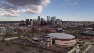 DX0001_001534 - 5.7K stock footage aerial video of the city skyline seen from while flying by arena, Downtown Denver, Colorado
