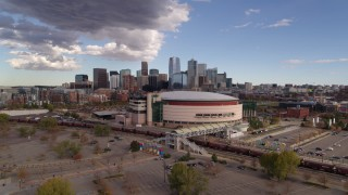 DX0001_001536 - 5.7K stock footage aerial video of the Pepsi Center arena with the city skyline in the background, Downtown Denver, Colorado