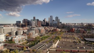 DX0001_001537 - 5.7K stock footage aerial video of the city skyline in the distance, Downtown Denver, Colorado