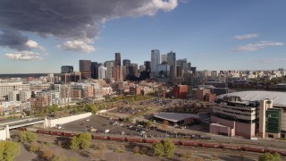 DX0001_001538 - 5.7K stock footage aerial video flyby the city skyline in the distance, reveal the arena, Downtown Denver, Colorado