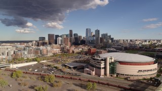 DX0001_001539 - 5.7K stock footage aerial video stationary view of arena, and the city skyline in the distance, Downtown Denver, Colorado