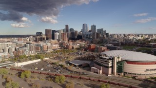 DX0001_001540 - 5.7K stock footage aerial video flyby arena with the city skyline in the distance, Downtown Denver, Colorado