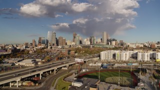 DX0001_001543 - 5.7K stock footage aerial video of the city skyline seen from W Colfax Avenue, Downtown Denver, Colorado