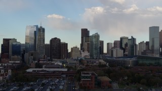 DX0001_001550 - 5.7K stock footage aerial video of passing the city skyline with clouds overhead, Downtown Denver, Colorado