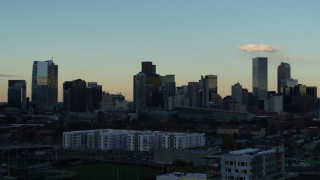 DX0001_001556 - 5.7K stock footage aerial video of the tall skyscrapers in the city skyline at sunset, Downtown Denver, Colorado