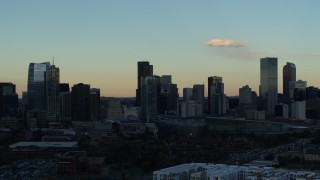 DX0001_001559 - 5.7K stock footage aerial video slowly flyby the towering skyscrapers in the city skyline at sunset, Downtown Denver, Colorado