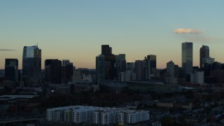 DX0001_001560 - 5.7K stock footage aerial video stationary view of towering skyscrapers in the city skyline at sunset, Downtown Denver, Colorado