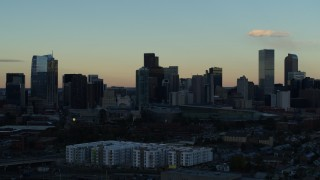 DX0001_001561 - 5.7K stock footage aerial video stationary view of skyscrapers in the city skyline at sunset, Downtown Denver, Colorado