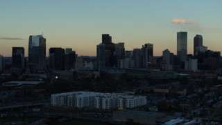 DX0001_001562 - 5.7K stock footage aerial video stationary view of the city's skyscrapers in the skyline at sunset, Downtown Denver, Colorado