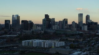 DX0001_001563 - 5.7K stock footage aerial video stationary view of the city's skyline at sunset before descent, Downtown Denver, Colorado