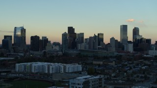 DX0001_001565 - 5.7K stock footage aerial video of slowly passing by the city's skyline at sunset, Downtown Denver, Colorado