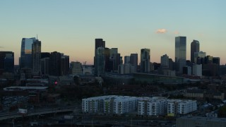 DX0001_001566 - 5.7K stock footage aerial video of a slow pass of the city's skyline at sunset, Downtown Denver, Colorado
