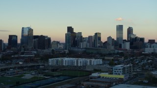 DX0001_001568 - 5.7K stock footage aerial video of a reverse view of the city's skyline at sunset before descent, Downtown Denver, Colorado
