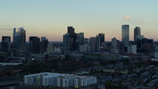 DX0001_001571 - 5.7K stock footage aerial video fly away from the city's skyline at sunset before descent, Downtown Denver, Colorado