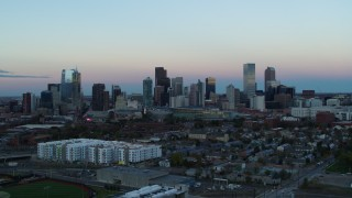 DX0001_001575 - 5.7K stock footage aerial video ascend for a view of the city's downtown skyline at sunset, Downtown Denver, Colorado