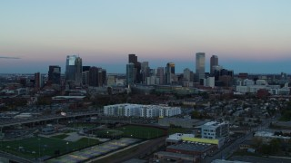 DX0001_001577 - 5.7K stock footage aerial video of a slow approach to the city's downtown skyline at sunset, Downtown Denver, Colorado
