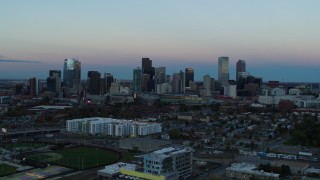 DX0001_001580 - 5.7K stock footage aerial video of a stationary view and flyby of the city's downtown skyline at sunset, Downtown Denver, Colorado
