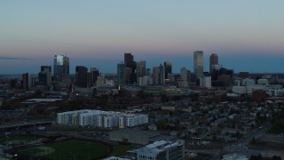 DX0001_001583 - 5.7K stock footage aerial video flyby the city's downtown skyline at sunset, seen while ascending, Downtown Denver, Colorado