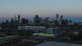 DX0001_001585 - 5.7K stock footage aerial video descend near baseball field with view of the city's downtown skyline at sunset, Downtown Denver, Colorado