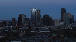 DX0001_001586 - 5.7K stock footage aerial video of skyscrapers and hotel high-rise at twilight, Downtown Denver, Colorado