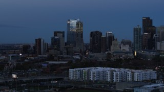 DX0001_001588 - 5.7K stock footage aerial video of flyby skyscrapers and hotel high-rise at twilight, Downtown Denver, Colorado