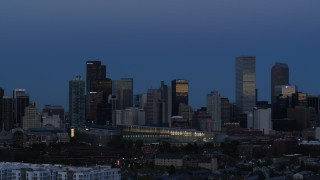 DX0001_001589 - 5.7K stock footage aerial video of flying by the city's downtown skyscrapers by convention center at twilight, Downtown Denver, Colorado