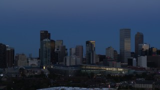 DX0001_001590 - 5.7K stock footage aerial video of passing by the city's downtown skyscrapers and convention center at twilight, Downtown Denver, Colorado