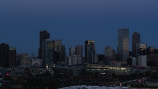 DX0001_001591 - 5.7K stock footage aerial video of the city's downtown skyscrapers by convention center at twilight, Downtown Denver, Colorado