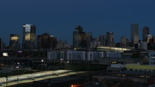 DX0001_001594 - 5.7K stock footage aerial video flyby and stationary view of the city's skyscrapers at twilight, Downtown Denver, Colorado