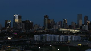 DX0001_001595 - 5.7K stock footage aerial video flyby the city's skyscrapers at twilight while ascending, Downtown Denver, Colorado