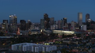 DX0001_001598 - 5.7K stock footage aerial video passing the city's skyscrapers and convention center at twilight, Downtown Denver, Colorado