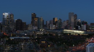 DX0001_001600 - 5.7K stock footage aerial video descend and flyby the city's skyscrapers and convention center at twilight, Downtown Denver, Colorado