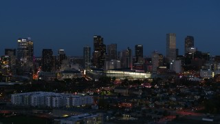 DX0001_001603 - 5.7K stock footage aerial video of the convention center and city skyline at twilight, Downtown Denver, Colorado
