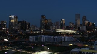 DX0001_001604 - 5.7K stock footage aerial video of the convention center and city skyline at twilight during slow descent, Downtown Denver, Colorado