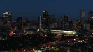 DX0001_001607 - 5.7K stock footage aerial video of the city skyline behind the convention center at twilight, Downtown Denver, Colorado
