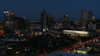 DX0001_001608 - 5.7K stock footage aerial video of the city skyline behind the convention center at twilight, Downtown Denver, Colorado