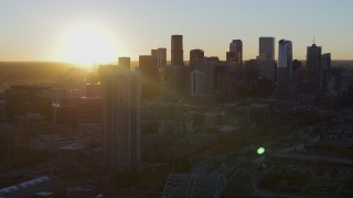 DX0001_001613 - 5.7K stock footage aerial video of the city skyline at sunrise, seen from residential skyscraper in Downtown Denver, Colorado