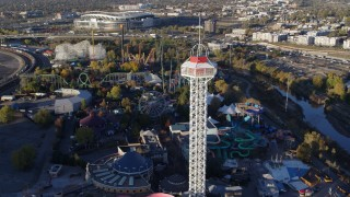 DX0001_001633 - 5.7K stock footage aerial video flyby rides at Elitch Gardens at sunrise in Downtown Denver, Colorado