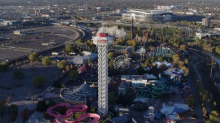 DX0001_001636 - 5.7K stock footage aerial video of flying by rides at Elitch Gardens at sunrise in Downtown Denver, Colorado