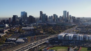 DX0001_001639 - 5.7K stock footage aerial video flying by the city skyline at sunrise in Downtown Denver, Colorado