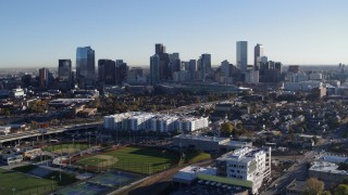 DX0001_001640 - 5.7K stock footage aerial video of a view of the city skyline at sunrise in Downtown Denver, Colorado